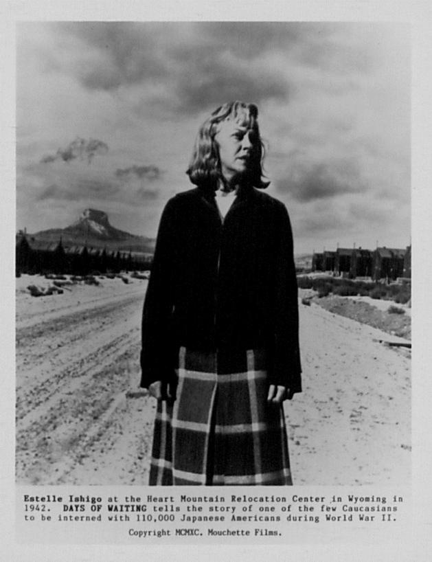 "Estelle Ishigo in plaid skirt and black jacket ""one of the few Caucasian women to be interned with 110,000 Japanese Americans,"" 1942. Box 1, Estelle Ishigo photographs."