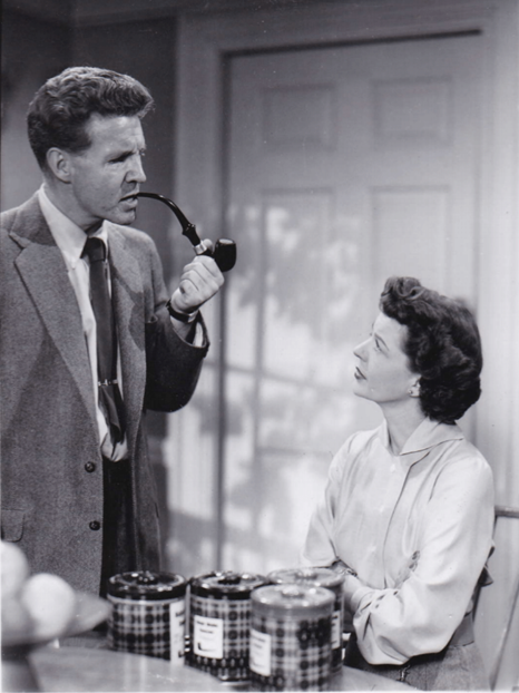 Ozzie and Harriet Nelson on set during the filming of an episode, undated. Box 57, Ozzie and Harriet Nelson Papers.