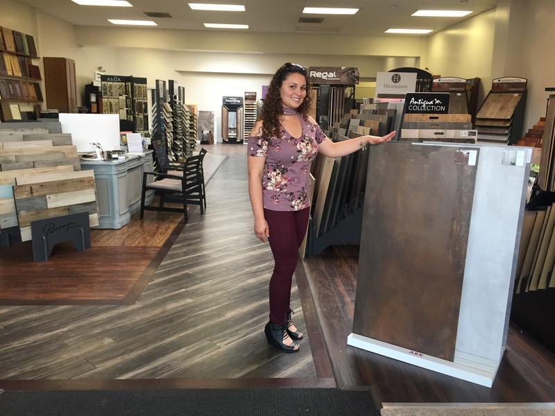 Entrepreneur Katrina Molina shows a flooring display at her Rawlins business, Interiors Galore.