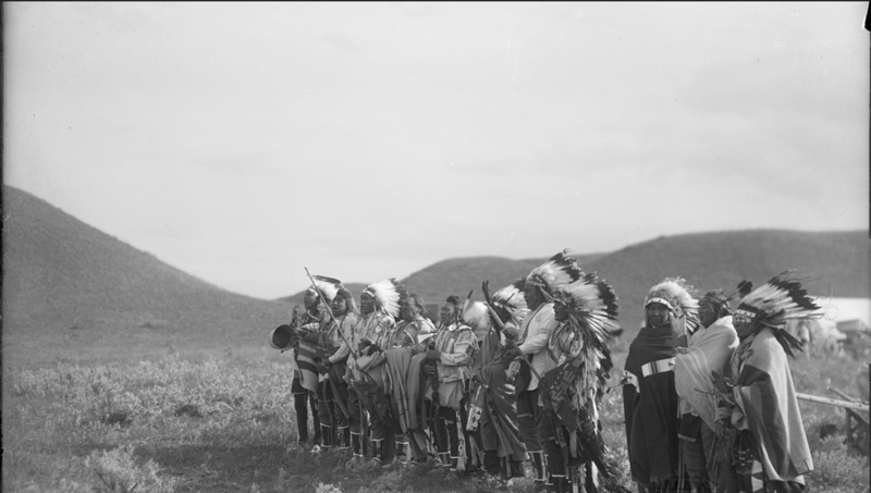 Photograph taken by Richard Throssel of a group of Native American people in ceremonial dress performing a song, circa 1902-1933. Box 17, Richard Throssel papers.