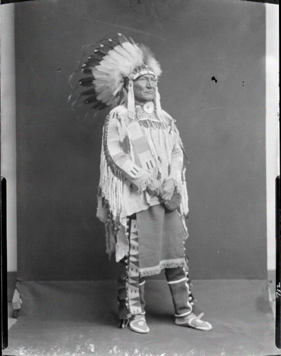 """Photograph by Richard Throssel of """"Cuts the Bear's Ears,"""" a member of the Crow tribe, circa 1902-1933. Box 27, Richard Throssel papers."""