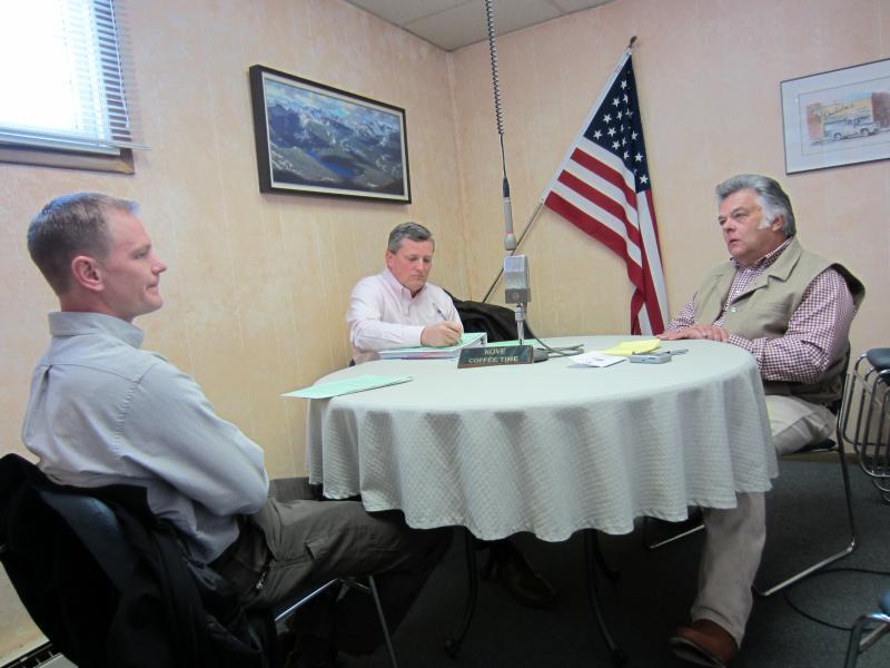 Leadership Wyoming participants Doran Fluckiger (left) and Dan Ewart (center) interview KOVE-AM broadcaster Joe Kenney of Lander about entrepreneurship.
