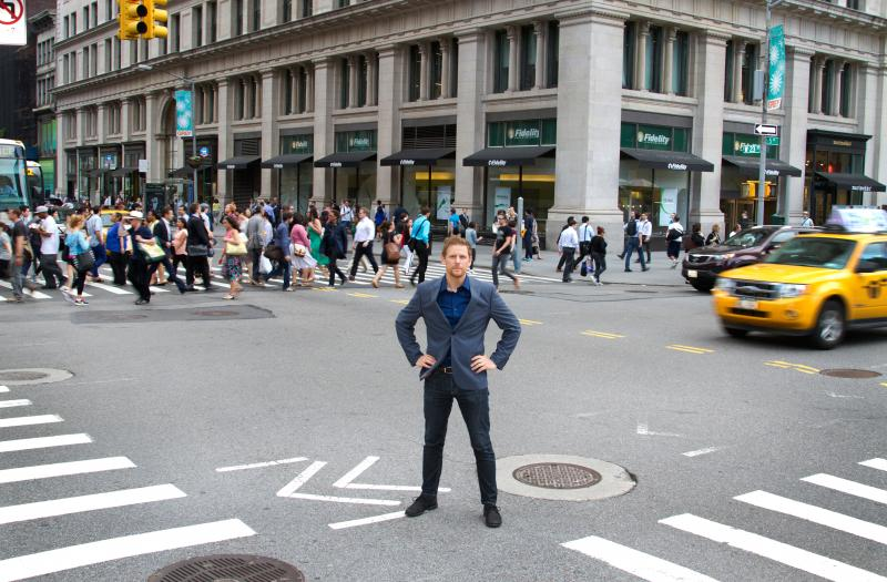 Charles Montgomery, author of Happy Cities, standing in road