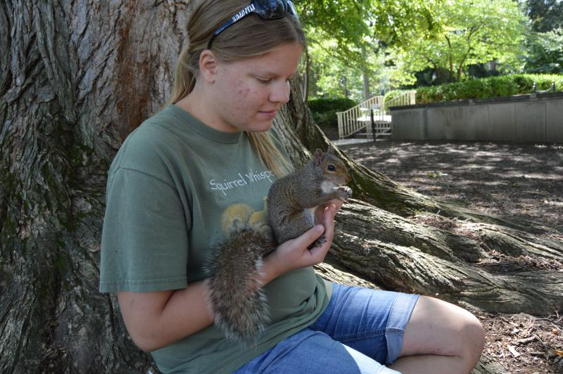 Mary Krupa holding Sneezy the Squirrel