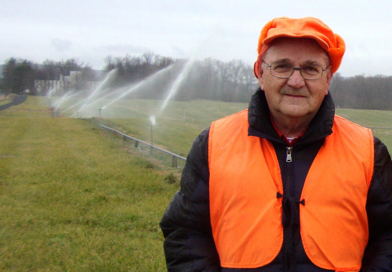 John Gaudlip in front of field with sprinklers.