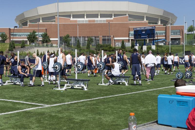 Players gather around weight equipment