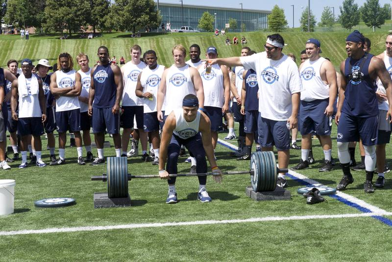 Football player lifts weights