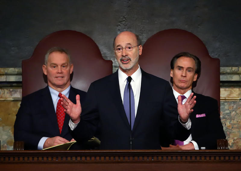 Gov. Tom Wolf, with Rep. Mike Turzai, R-Allegheny and Lt. Gov. Mike Stack behind him.