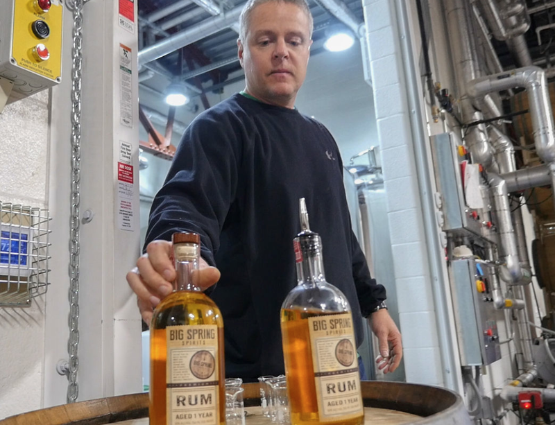 Kevin Lloyd sets out bottles of Big Spring whiskey for a tour.