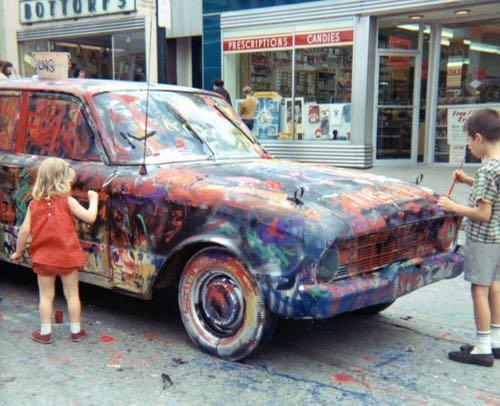 Kids painting an old car at the arts festival in 1967.
