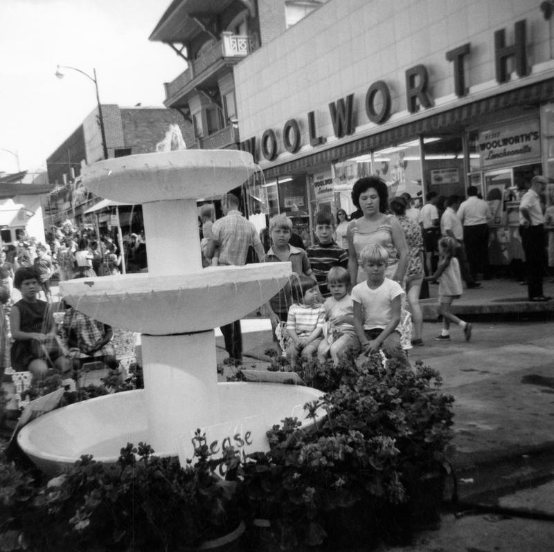 Festival goers gather in front of Woolworth in 1967.
