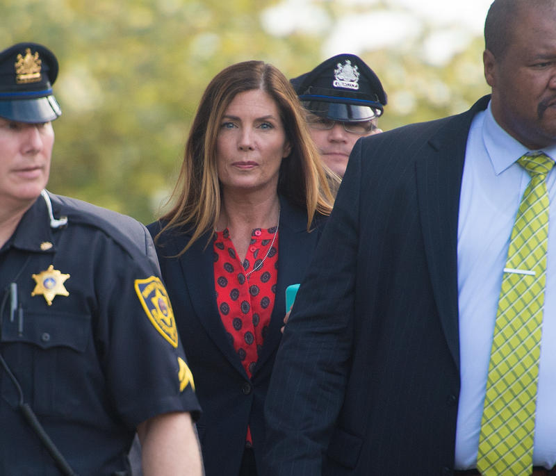 Kathleen Kane with police officers