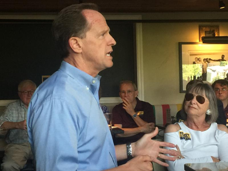 Republican U.S. Senator Pat Toomey speaks with supporters at Champs Sports Grill in State College, Pa. on August 16, 2016.
