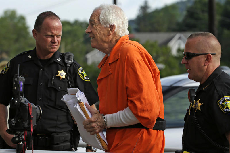 Former Penn State University assistant football coach Jerry Sandusky, center, arrives at the Centre County Courthouse for an appeals hearing about whether he was improperly convicted four years ago, in Bellefonte, Pa. Friday, Aug. 12, 2016.