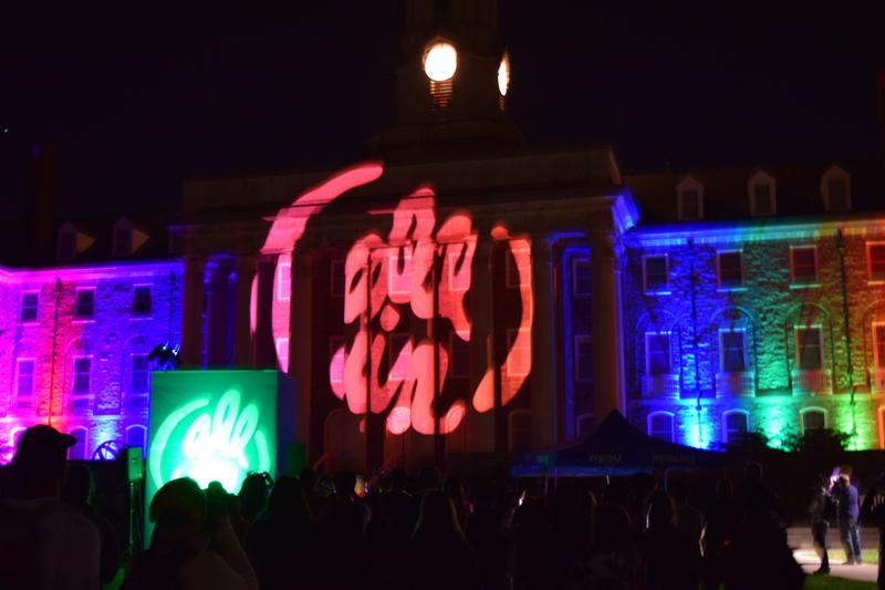 "A video presentation launching the ""All In at Penn State"" program plays on the Old Main facade on Penn State's University Park campus on October 6, 2016."