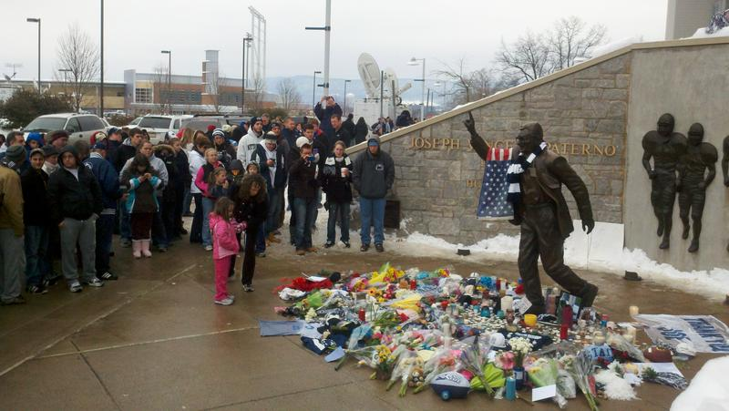 Paterno statue with crowd