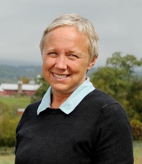 Hannah Smith-Brubaker in front of a farm