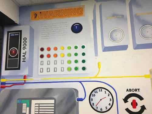 "Notice HAL from ""2001"" on the mural's spaceship control panel, in an alcove near the stairwell."
