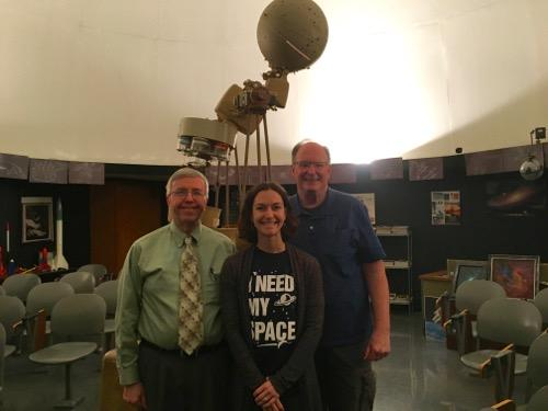 Rick Imler, Lynette Luke & Fred Marschak in front of the antique star ball projector in the planetarium.