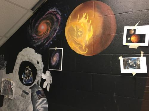 Part of a mural-in-progress outside the planetarium
