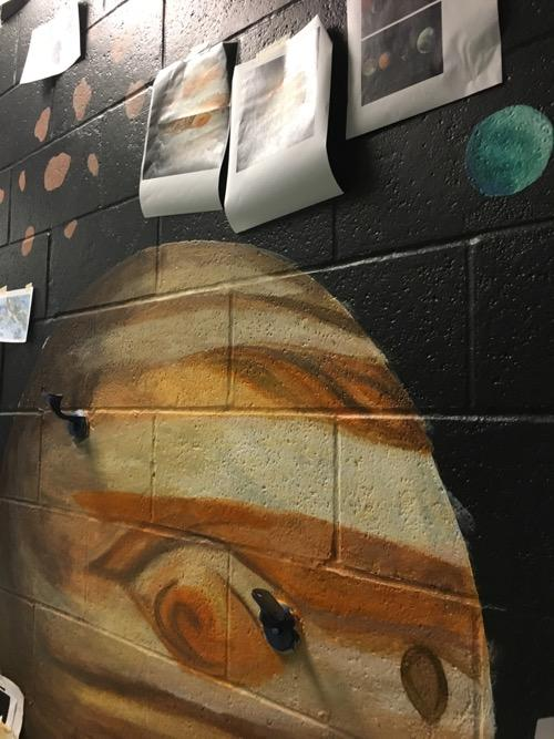 Jupiter, with its red spot, as part of the mural.