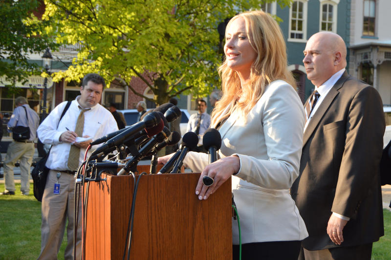 Stacy Parks Miller talks to reporters at the end of the first day of the preliminary hearing in the trial of fraternity members in the hazing-related death of Timothy Piazza. The detective on the case, David Scicchitano from the State College police depar