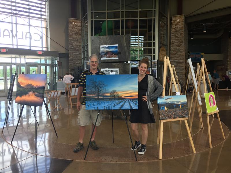 Event organizers Howie Shultz and Shelby Caraway stand behind one of Shultz's pieces for sale at the Art with a Heart event on Saturday.
