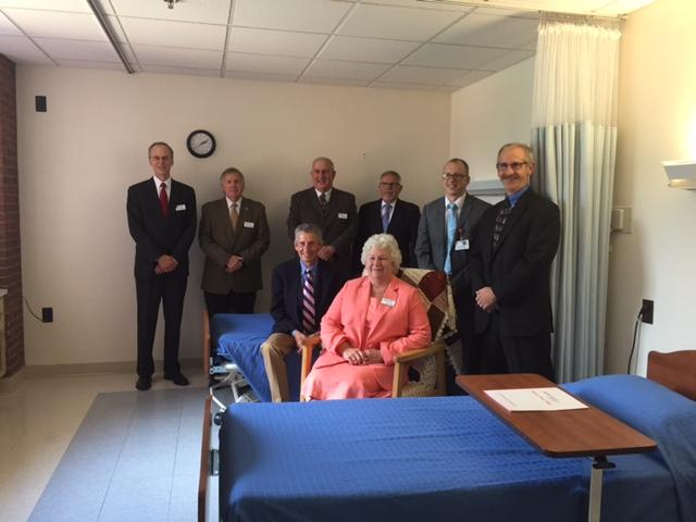 Rooms for residents like the one pictured will be 100-square-feet larger in the new building. Pictured from left are Centre Crest board members Richard Wisniewski; Larry Bickford; Bill Rockey; Carl Raup; Al Jones; Betsy Boyer Andrew Naugle, Centre Crest A