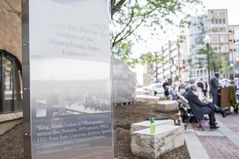 The Martin Luther King Jr. Plaza features a sweeping wall, depicting images of the 1965 speech Dr. King gave at Penn State's Rec Hall.