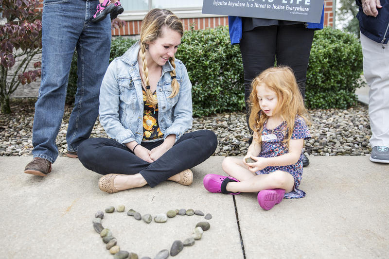 Brianna Hall, left, and her daughter, Elle Ozaki, 4, were among the protestors.