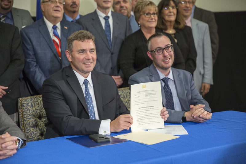 Pennsylvania Department of Community and Economic Development Secretary Dennis Davin (left) and Altoona Mayor Matt Pacifico pose for a photo with the official rescission letter. Altoona officially exited Act 47 on Wednesday.