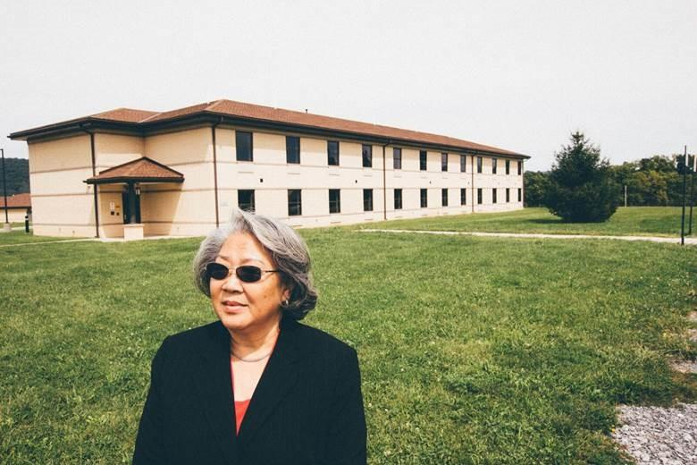 Ho-Thanh Nguyen went back to Fort Indiantown Gap recently. Here, she's in front of the National Guard training area where her barracks stood in 1975. She and her siblings lived here when they first resettled in the United States after fleeing Vietnam.