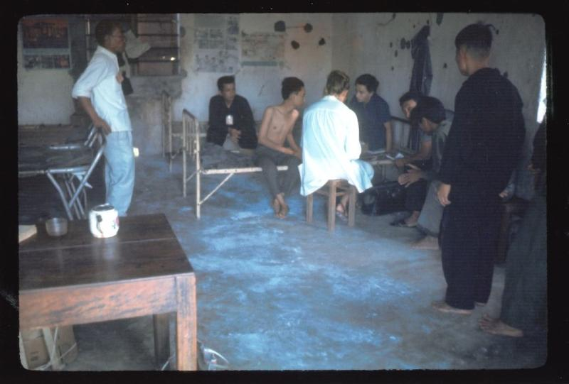 Dr. Marge Nelson (in white coat) assisting patients at the Quang Ngai province prison in 1969.