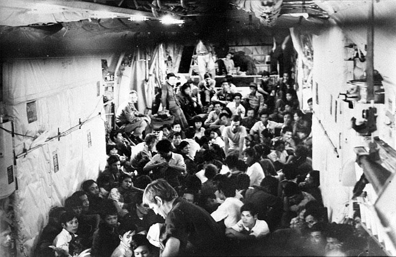 South Vietnamese refugees in the cargo compartment of a C-130 in April 1975