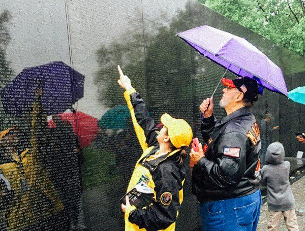 Jeff Butch searches for Lonnie Newland's name on the Vietnam Wall in Washington D.C.