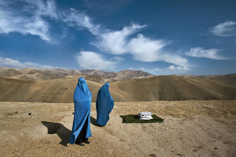 An Afghan woman, Noor Nisa, stands in labor on the side of the mountain in Badakhshan Province, Afghanistan, November 2009.