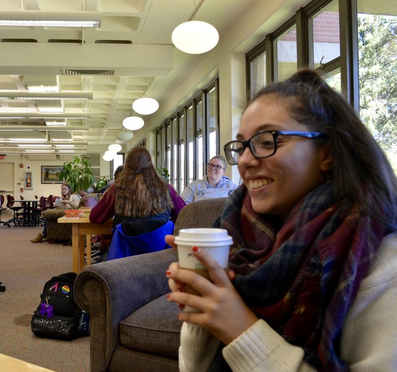 Marissa May holding a coffee cup. She is a senior health sciences major and one of the last dance minors able to complete her coursework after the minor was cut recently.