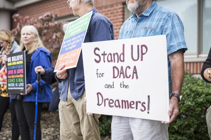 "Protestors held signs that read ""stand up for DACA"""