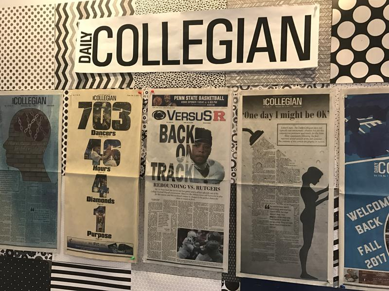 Past Daily Collegian newspapers hang along the walls of the Collegian office.