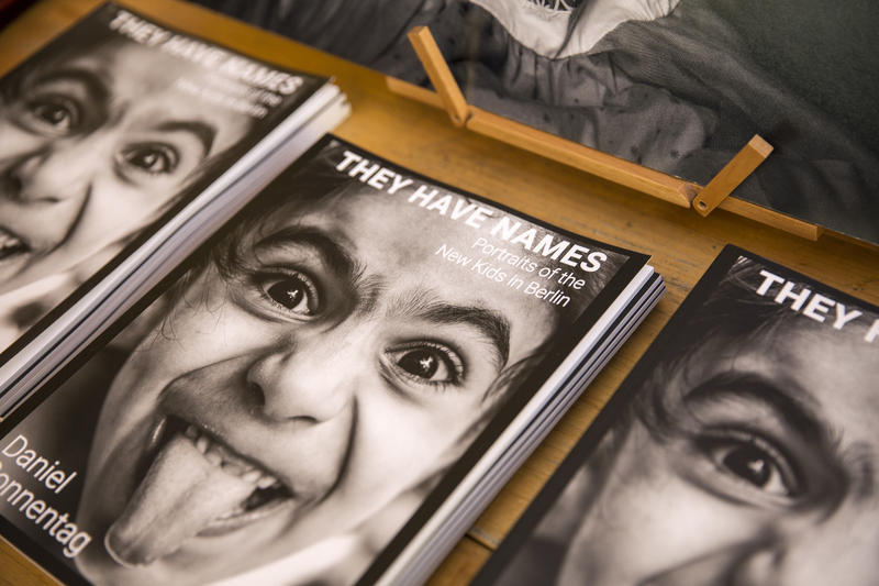 An image of the booklets containing photographs and stories of refugee children that are on sale at Webster's Bookstore in downtown State College.