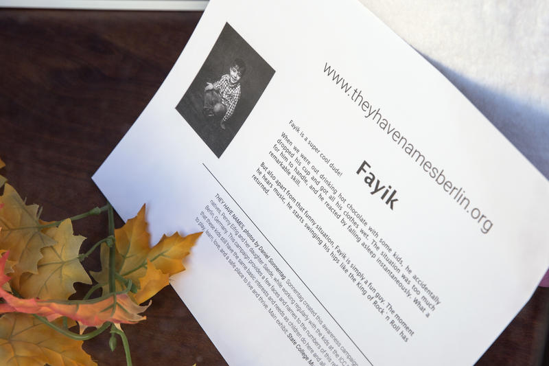 A story about Fayik, one of the refugee children featured in the photo series. These stories accompany the photographs that appear in State College businesses' window displays.