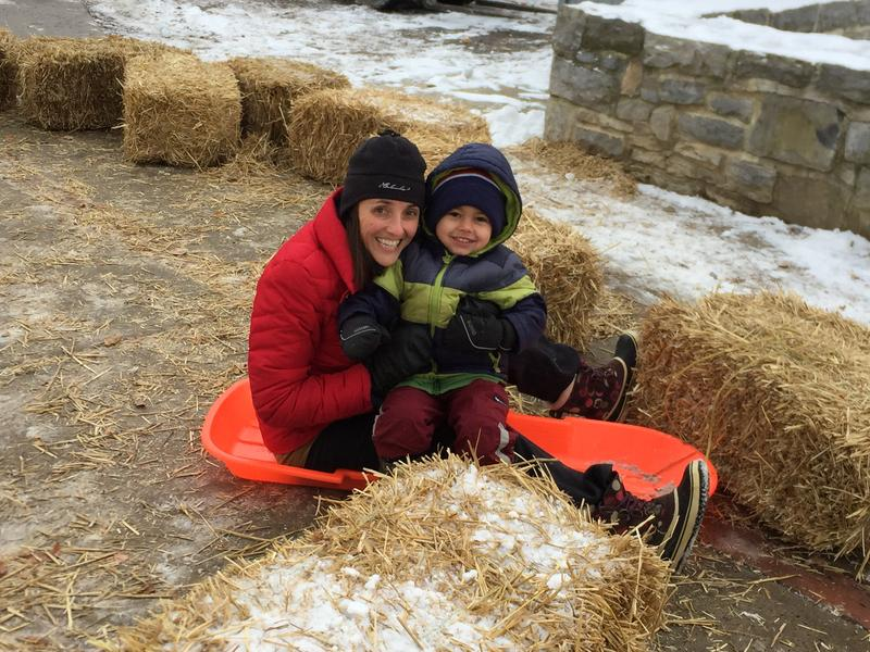 Megan Orient and her son, Michael, enjoyed the ice slide that's part of First Night State College.