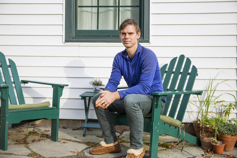 Matt Rooke sits outside of his home in State College, Pennsylvania. A former resident at the Hilltop Mobile Home Park, Rooke said his experience of being displaced gave him insights into the affordable housing problem in the area.