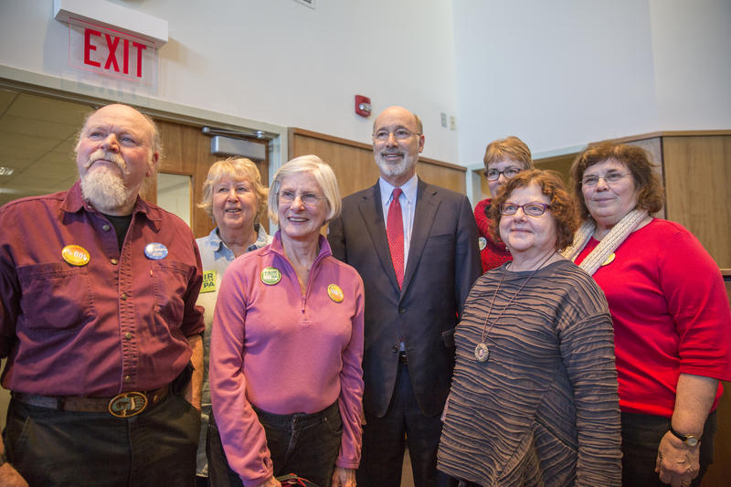 Governor Tom Wolf and residents attending Tuesday's discussion pose for a group photo in the council chamber of the State College Municipal Building.