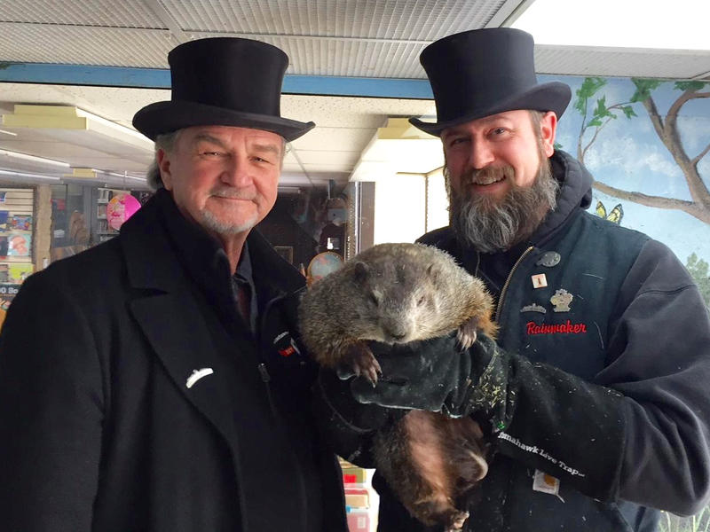 John Griffiths and A.J. Dereume, co-handlers of Punxsutawney Phil, stand with the famous groundhog