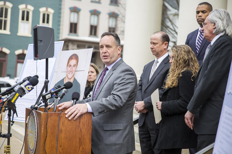 "Outside the courthouse, during a break from the proceedings on Friday, state Senate Majority Leader Jake Corman released the details of the ""Timothy J. Piazza Antihazing Law,"" joined by the Piazza family and Penn State president Eric Barron."