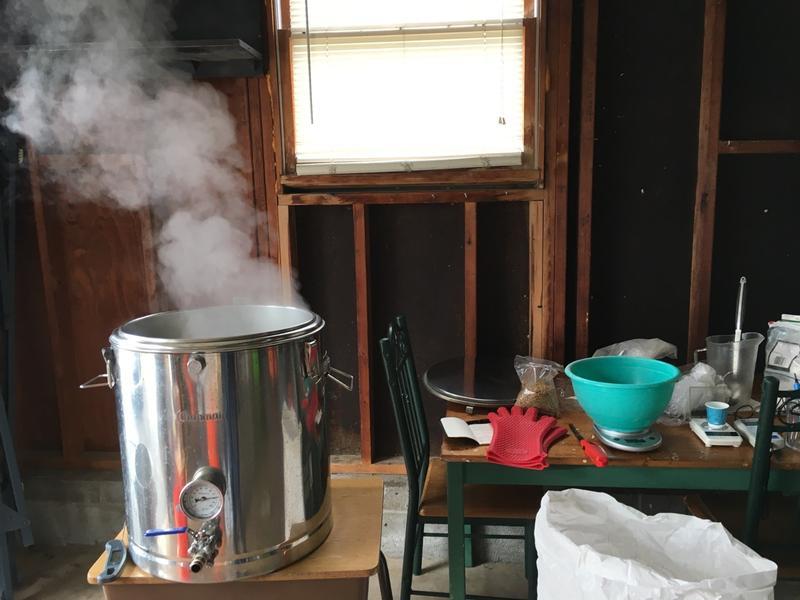 Steam rises from the mash tun in Baskin's garage.