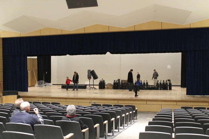 Community members tour the newly renovated south auditorium. A larger auditorium will be added in the next building phase.