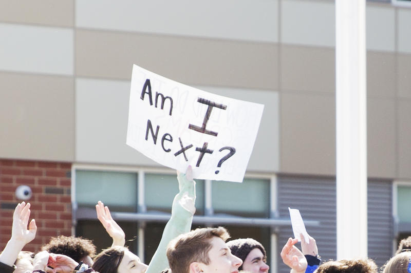 Students chanted and held signs during the walkout.