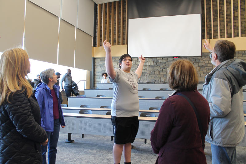 State High senior Nick Gibson tells his tour group about the projectors in one of the new lecture halls at State High.